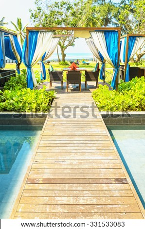 Beautiful luxury resort with an amazing sunbathing place in the garden of the hotel, sun loungers on small islands in the swimming pool,Sri Lanka, Asia - stock photo