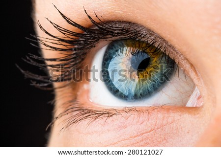 beautiful macro of an eye looking up - stock photo