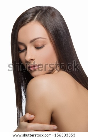 Beautiful make-up. Rear view of beautiful women with make-up looking over shoulder while isolated on white - stock photo