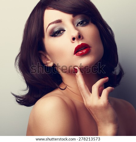Beautiful makeup face of female model with bright red lips. Closeup color portrait - stock photo
