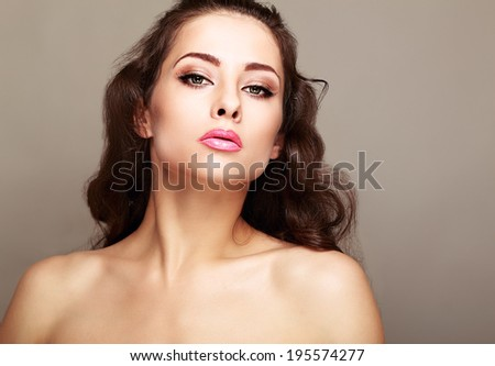 Beautiful makeup woman with long hair looking sexy - stock photo