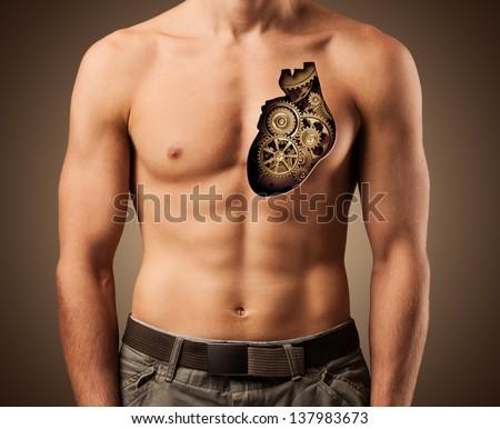 Beautiful male torso. Healthy human heart. Fitness - stock photo