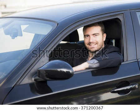 Beautiful man driving very happy his car - stock photo