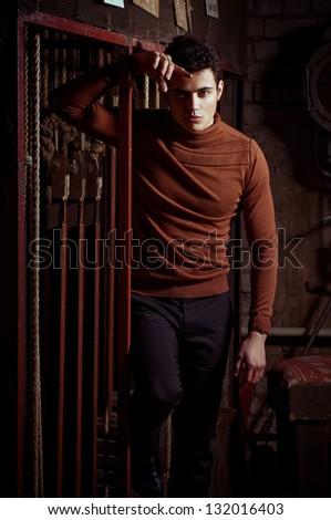 Beautiful man in fashionable clothes. Fashion portrait - stock photo