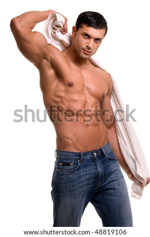 Beautiful man with muscular body holding the towel. - stock photo