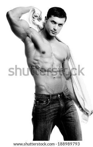 Beautiful man with muscular body holding the towel in black and white - stock photo