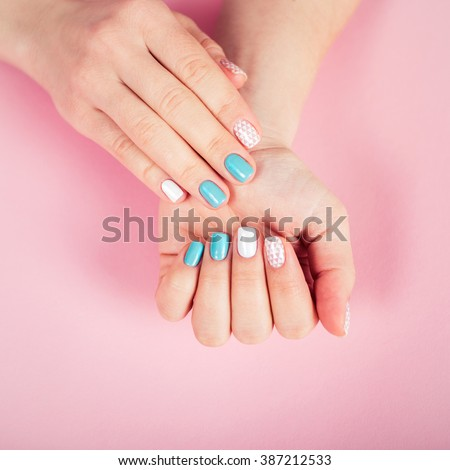 beautiful manicure. gel polish coating in white and turquoise, stamping. - stock photo