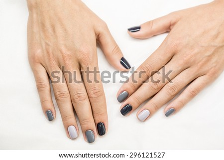 Beautiful manicure on hands of the girl - stock photo