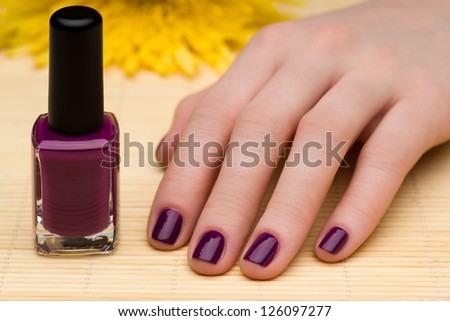 Beautiful manicure with a flower - stock photo