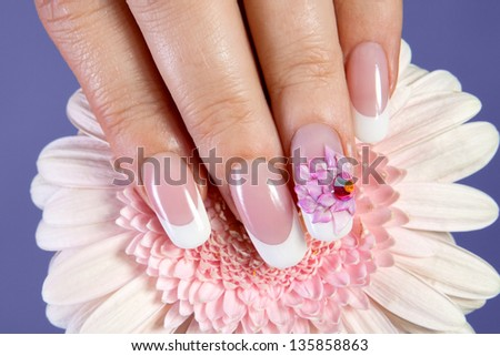Beautiful manicure with pink flower design - stock photo