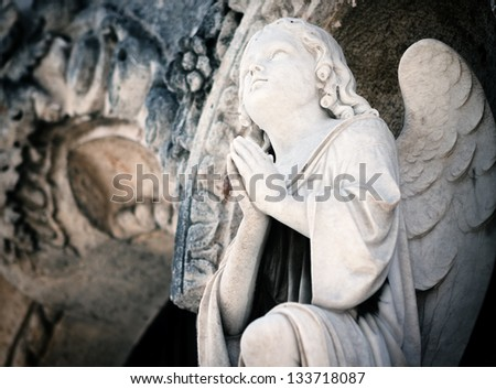 Beautiful marble angel praying - stock photo