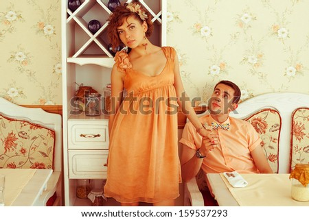 Beautiful married couple of hipsters in trendy clothing sitting in vintage cafe with white furniture. Vintage design and accessories. Wedding day. Daylight. Copy-space. Indoor shot - stock photo