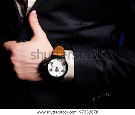 Beautiful masculine hand with a clock - stock photo