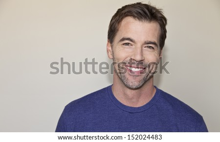 Beautiful mature man smiling - stock photo