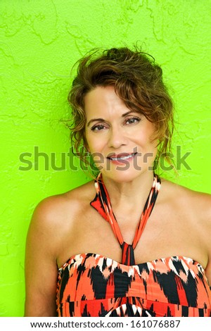 Beautiful Mature Woman against green background - stock photo