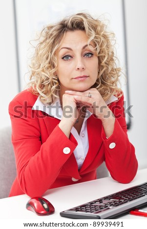 Beautiful mature woman at work in the office - stock photo