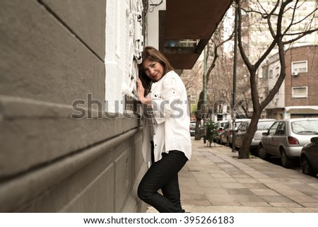 Beautiful mature woman cheerful on streets of Buenos Aires, Argentina. - stock photo