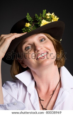 Beautiful mature woman in a hat. - stock photo