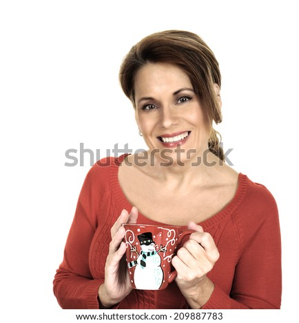 Beautiful Mature Woman in a Red Sweater holding a Christmas Cup - stock photo