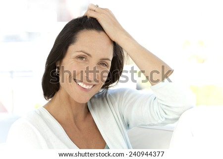 Beautiful mature woman relaxing - stock photo