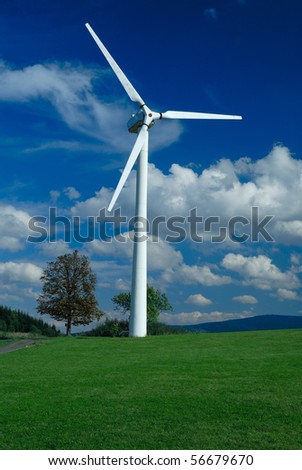 Beautiful meadow with alone wind turbine - stock photo