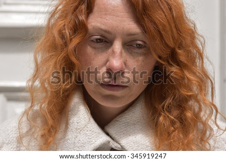 beautiful melancholic woman long curly hair without makeup against light white background looking down close up fashion vogue outdoor - stock photo