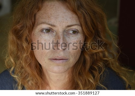 beautiful melancholic woman without makeup looking away thinking about problems   - stock photo