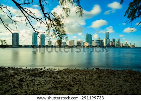Beautiful Miami skyline along Biscayne Bay from Key Biscayne with tall Brickell Avenue condos and office buildings in the background. - stock photo
