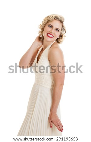 Beautiful mid 30s blond woman dressed in retro vintage white dress isolated on a white background - stock photo