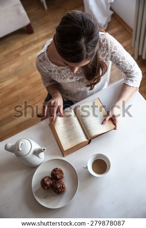 Beautiful middle age woman reading book at home. - stock photo