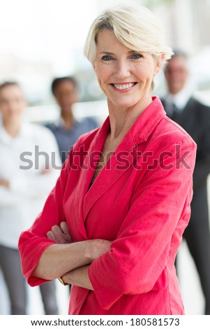 beautiful middle aged businesswoman with arms crossed - stock photo
