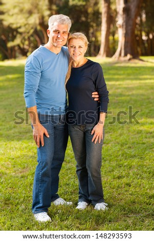 beautiful middle aged couple outdoors - stock photo