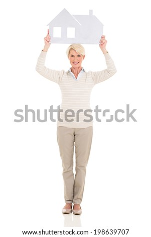 beautiful middle aged woman holding paper house on white background - stock photo