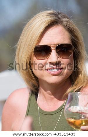 Beautiful middle-aged woman outside - stock photo