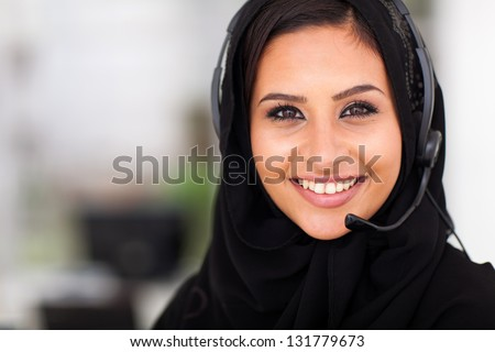 beautiful middle eastern businesswoman with headphones closeup head shot - stock photo