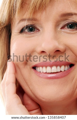 Beautiful middleaged woman with short hair on a white background - stock photo