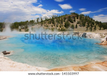 Beautiful Midway Geyser Basin against blue sky in Yellowstone National Park, Wyoming, US - stock photo