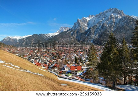 Beautiful mittenwald village and karwendel mountains, in early spring - stock photo
