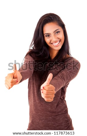 Beautiful mix race woman showing thumbs up - stock photo