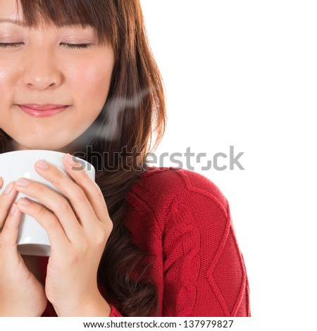 Beautiful mixed Asian young woman enjoying a cup of coffee, with coffee smoke and copy space on right, isolated on white background. - stock photo