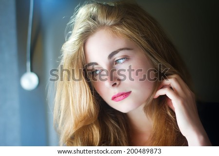 Beautiful Model Basking In The Natural Light Through Her Bedroom Window - stock photo