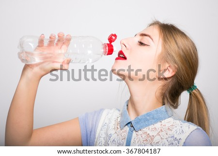 beautiful model drinks water for refresh herself - stock photo