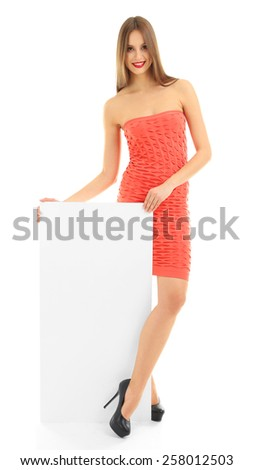 Beautiful model in dress with blank poster isolated on white - stock photo