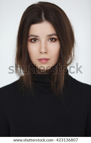 Beautiful model lady with natural make-up and brunette hair. Studio fashion shot on white background. Perfect skin. - stock photo