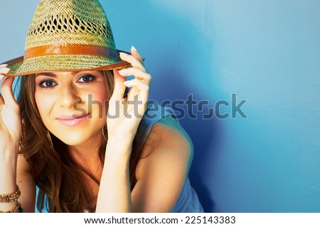 beautiful model portrait on blue background . young modern style woman close up face . - stock photo