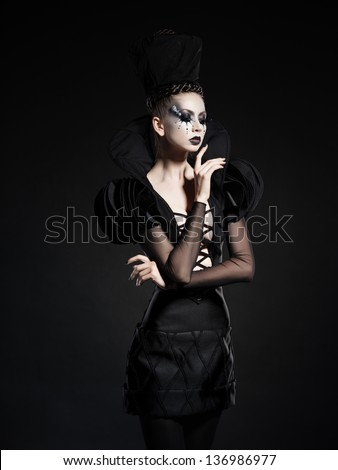 beautiful model posing as chess queen - fashion and beauty concept - stock photo