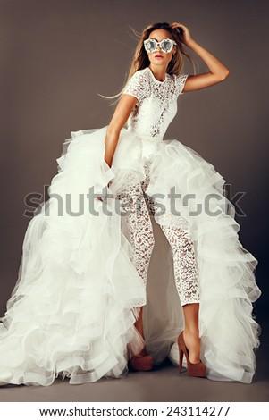 beautiful model posing in wedding dress - stock photo