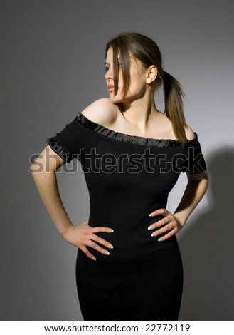 beautiful model wearing black dress - stock photo