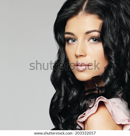 Beautiful model with curly hair, fashion portrait - stock photo