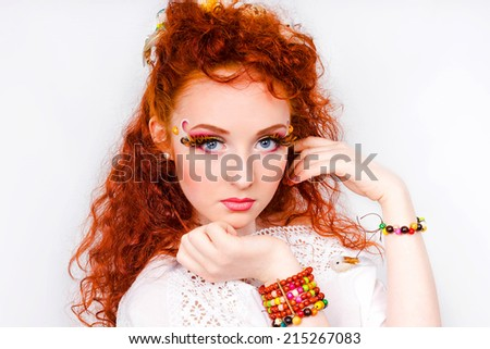 Beautiful model with decorative make-up isolated on white background - stock photo